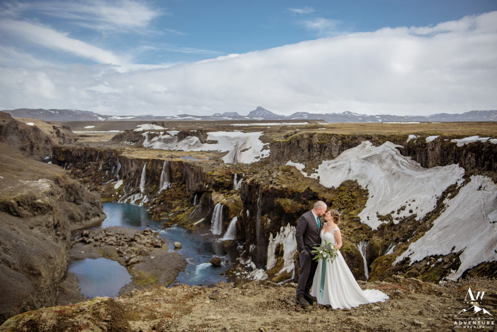 Iceland Adventure Wedding Couple looking at each other in front of a canyon