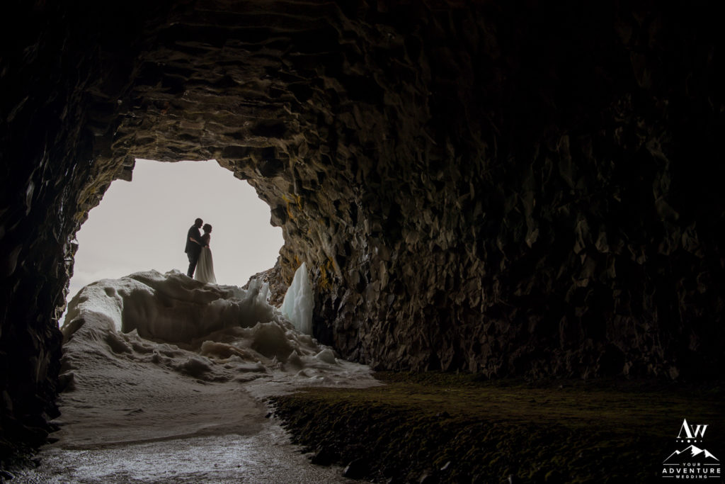 Iceland Elopement Couple looking at each other in a cave