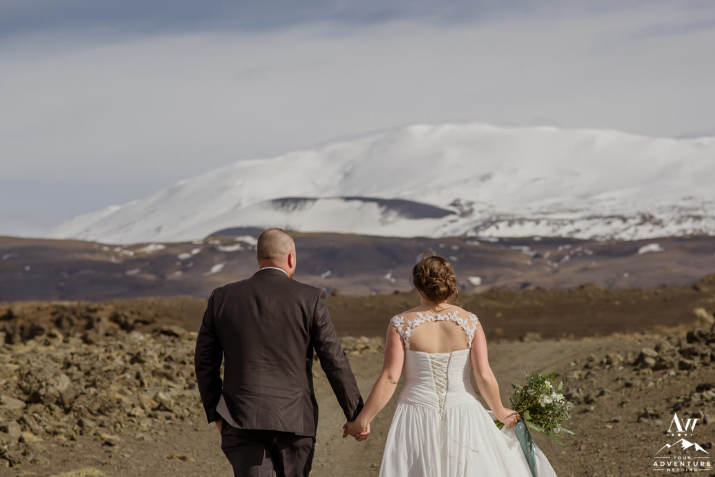 Couple walking towards Hekla Volcano in Iceland