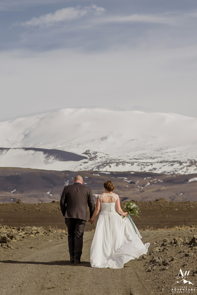 Iceland Elopement Couple walking towards Hekla Volcano