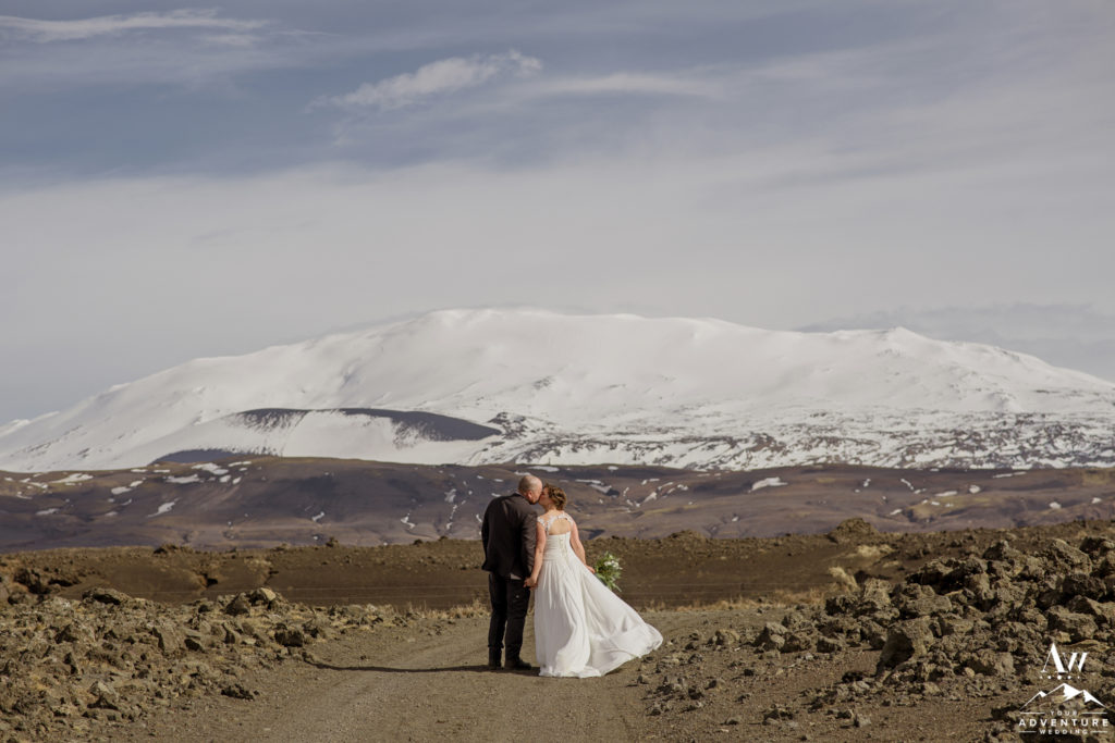 Iceland Wedding Couple kissing in front of Hekla Volcano