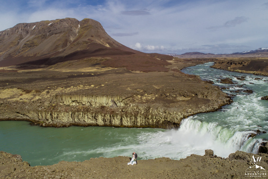 Iceland Drone Wedding Photo in front of a mountain and waterfall