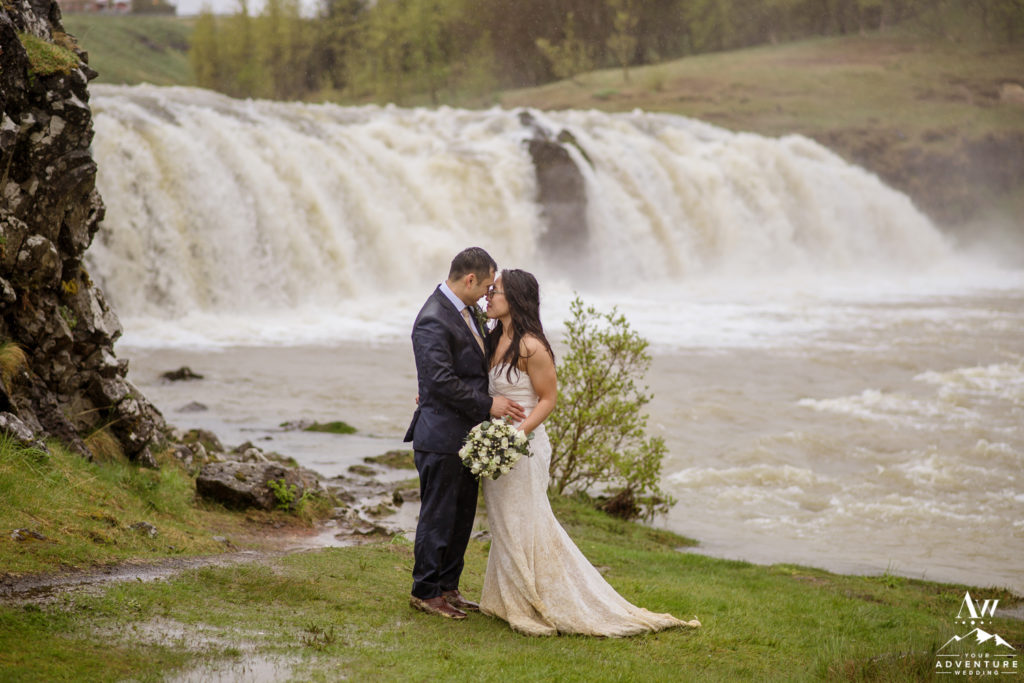 Romantic Iceland Wedding Photos in front of a waterfall
