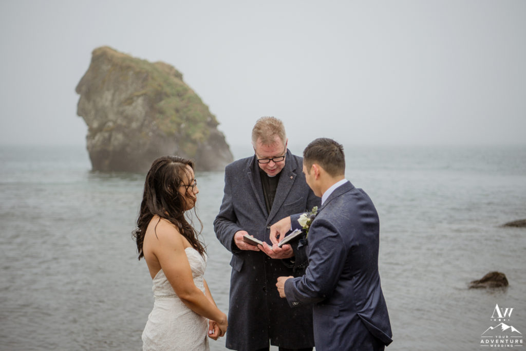 Iceland Wedding Couple Exchanging Rings during rainy ceremony