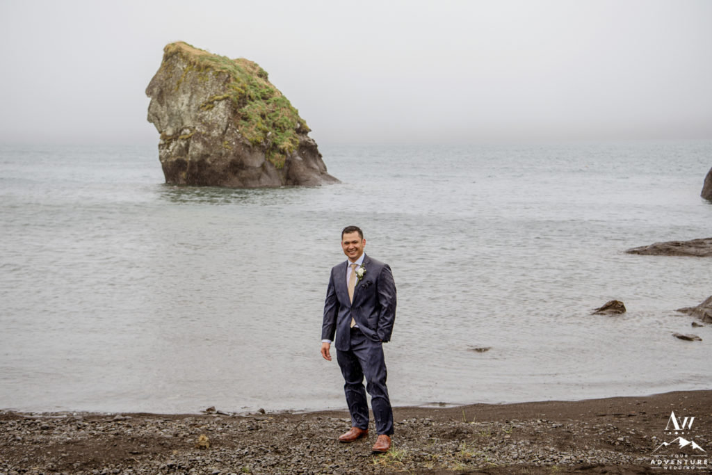 Groom during rainy Iceland wedding day