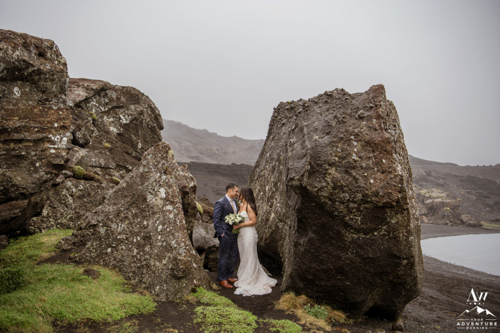 Iceland Wedding Couple cuddling up during rainy wedding adventure