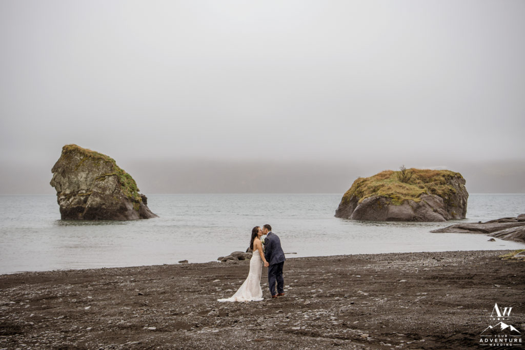 Iceland Wedding Couple Kissing in front of a lake during wedding adventure
