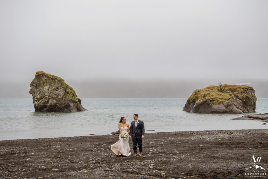 Iceland Wedding Couple walking on a black beach