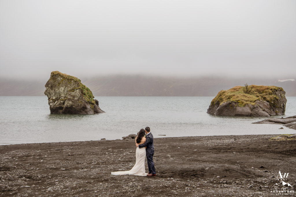 Iceland Wedding couple during wedding photos on a black beach