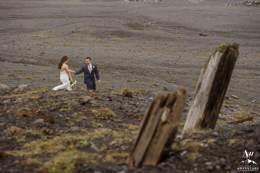 Iceland Wedding Couple walking on black beach