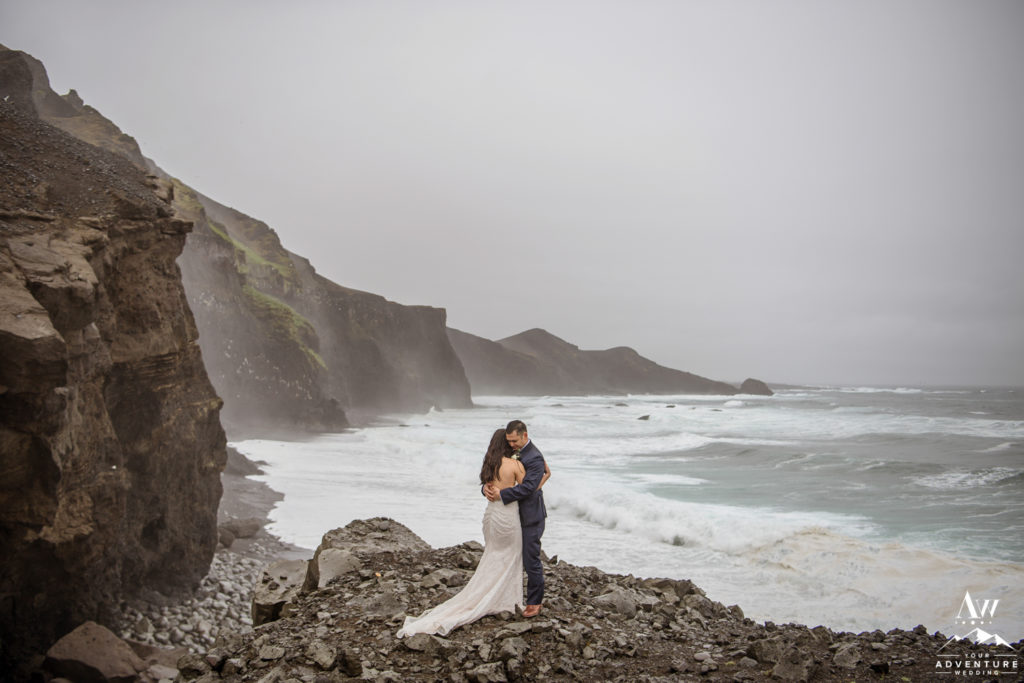Couple hugging during rainy Iceland wedding day