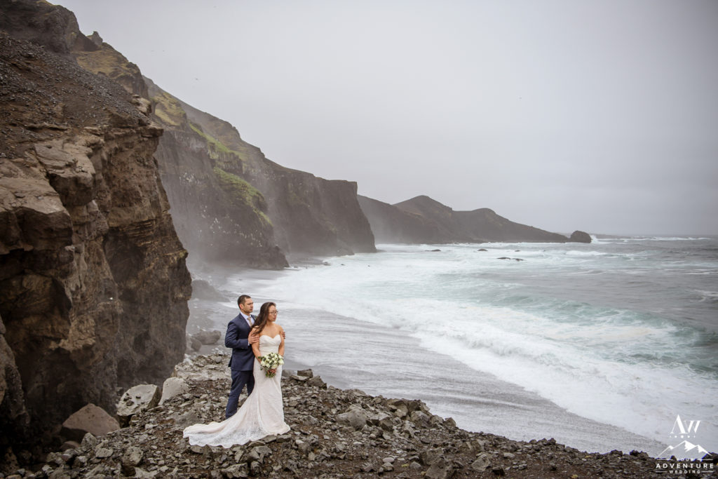 Dramatic Iceland Wedding Photos during rainy wedding adventure