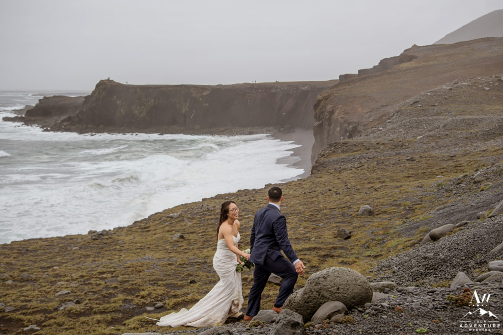 Iceland Wedding Couple hiking up a cliff