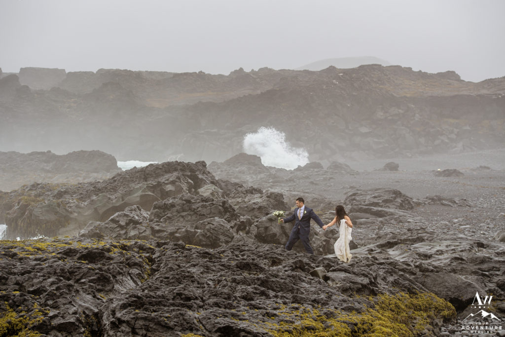 Iceland Wedding Couple Walking on Lava Rocks