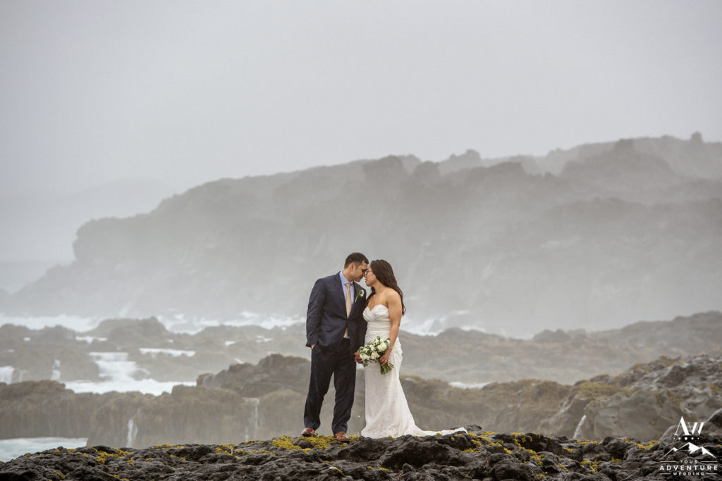Rainy Iceland Wedding Day couple looking at each other