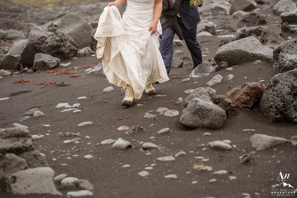 Iceland Wedding Couple hiking on a black sand beach