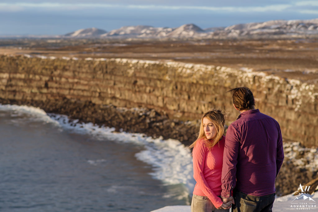 Iceland Engagement Session Couple on Golden Cliffs