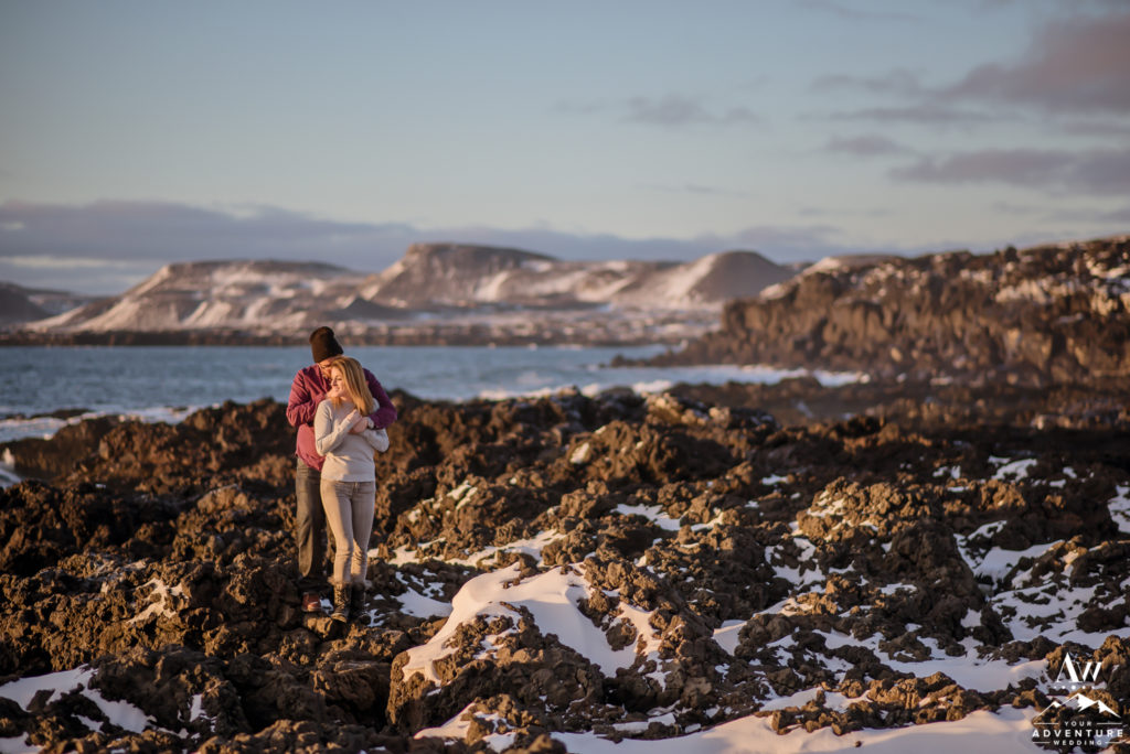Adventurous couple in Iceland during engagement session
