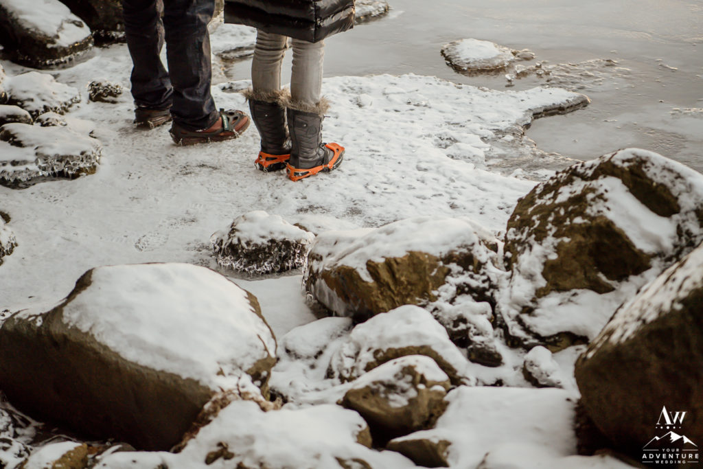 Adventurous couple wearing crampons during Iceland engagement session