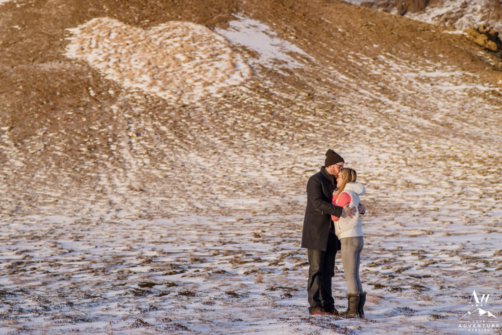 Couple Kissing in front of a heart shaped mountain