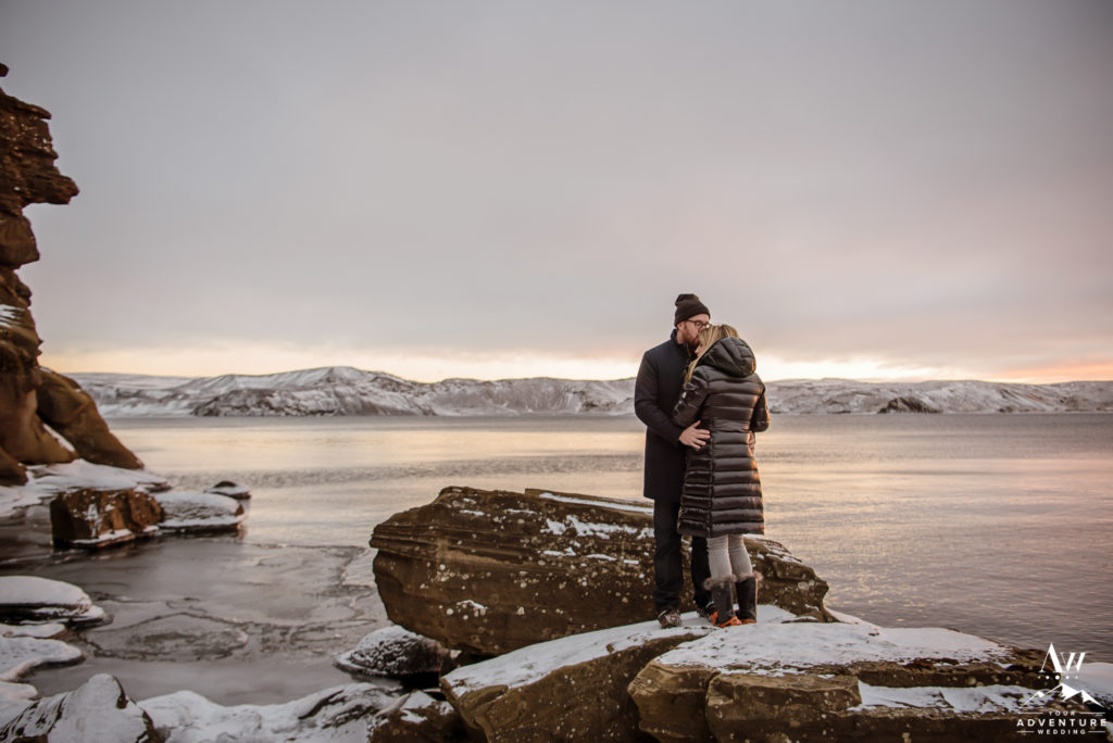 Iceland Engagement Couple at sunset on a lake
