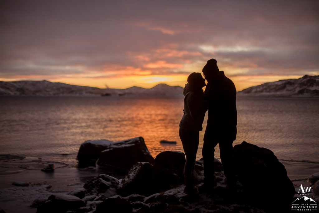 Couple looking at each other during a sunset Iceland engagement session