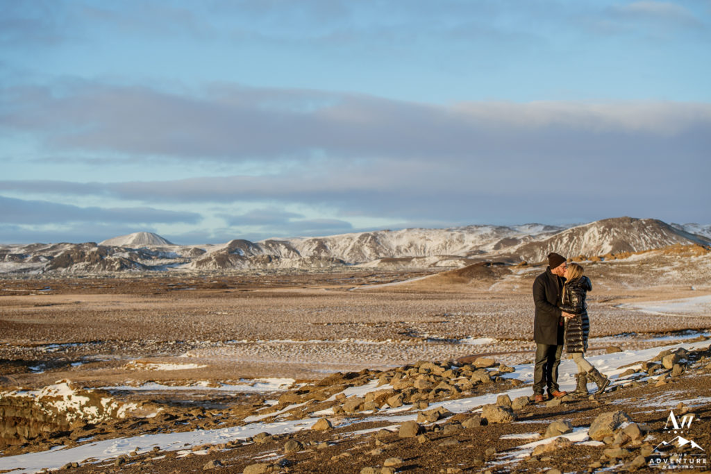 Winter Iceland Engagement Session on golden cliffs
