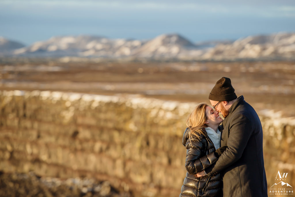 Couple kissing on top of golden cliffs in Iceland