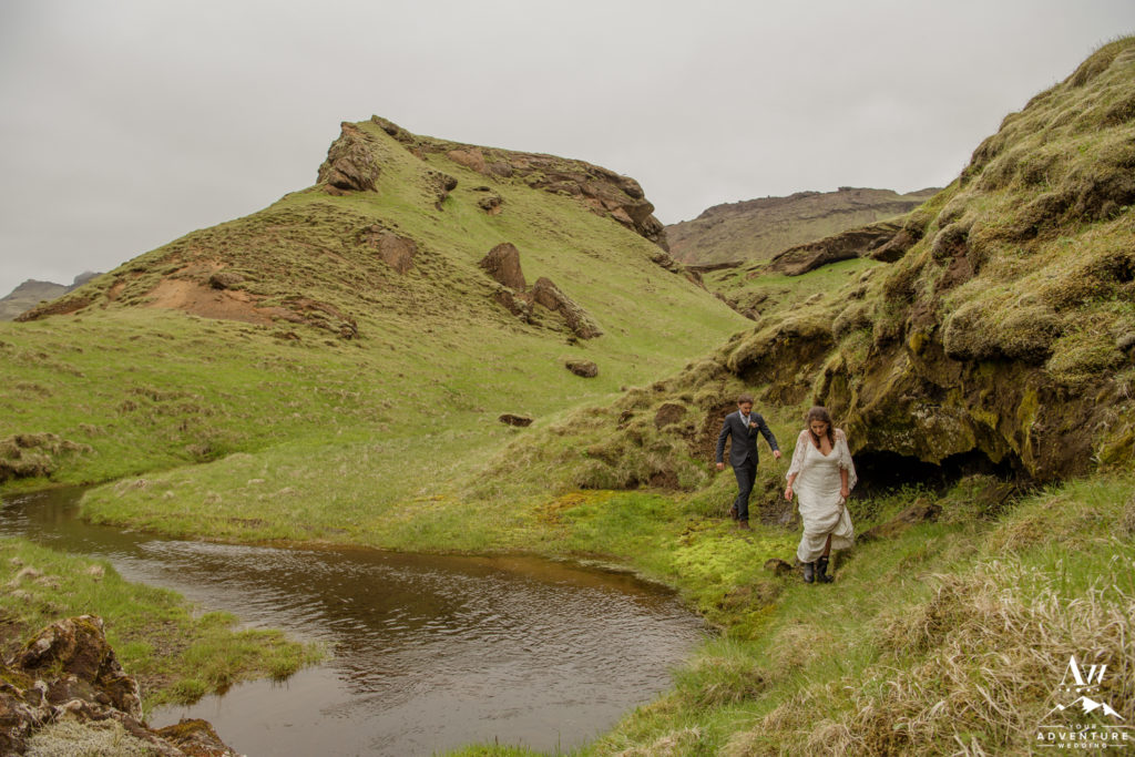 Iceland Wedding Couple hiking from a waterfall on their wedding day