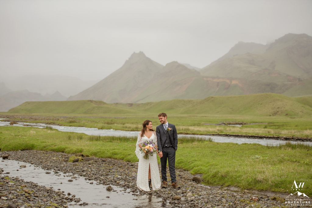 Couple during Iceland wedding day mountains behind