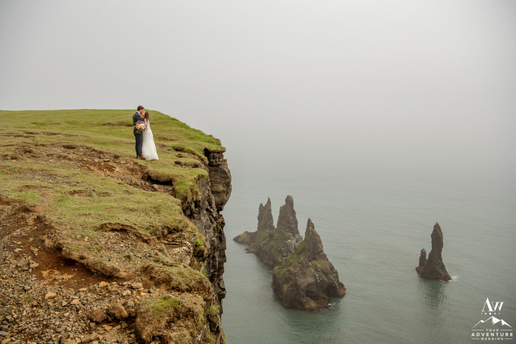 Adventurous Iceland wedding couple on top of reynisfjall mountain