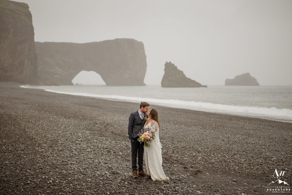Dyrholaey Sea Arch in Iceland Couple Exploring it
