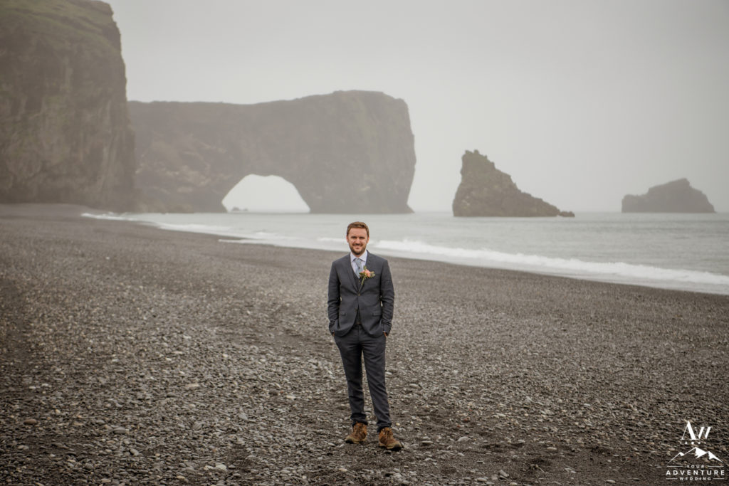 Groom Standing in Front of Dyrholaey Sea Arch