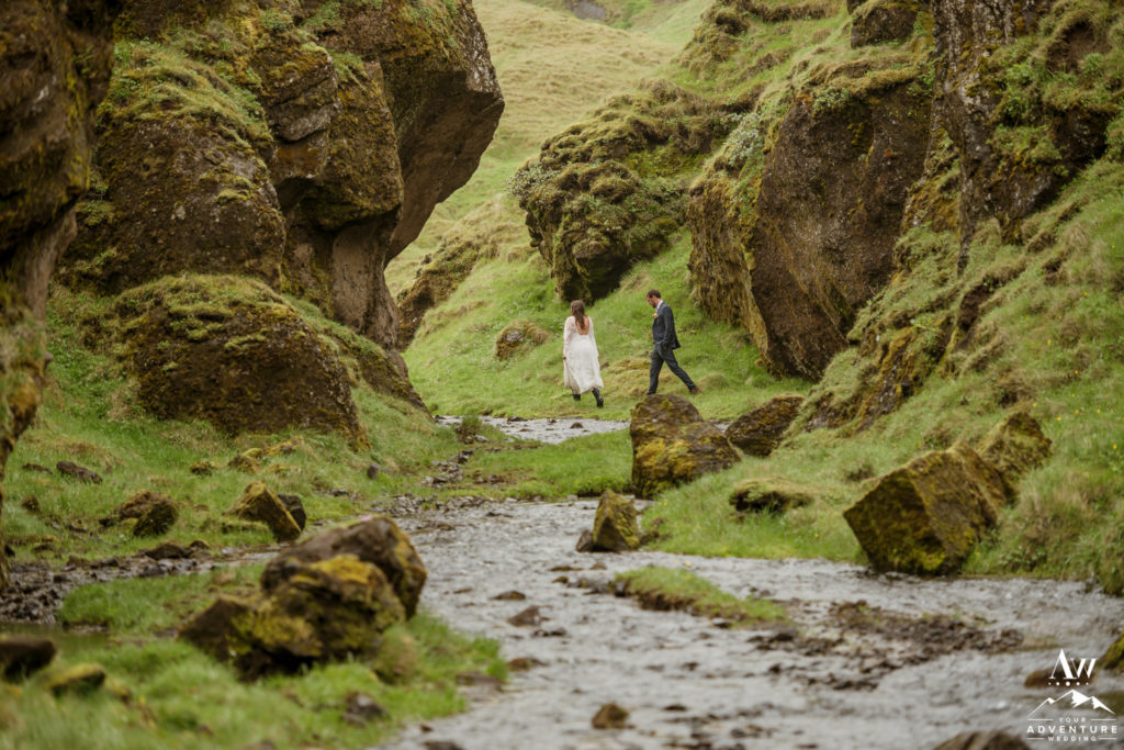 Iceland Elopement couple exploring a narrow canyon on wedding day