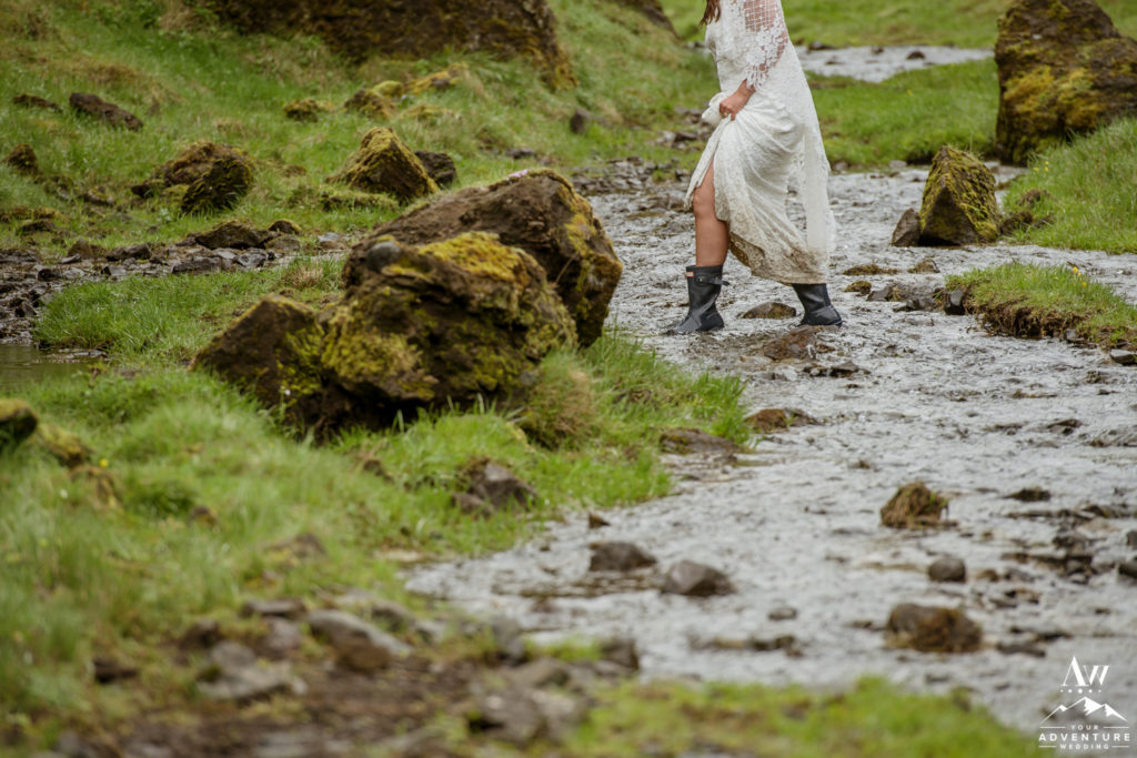 Iceland Elopement Bride hiking in a river