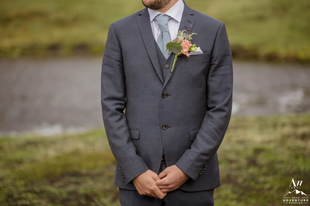 Closeup of adventure wedding groom suit
