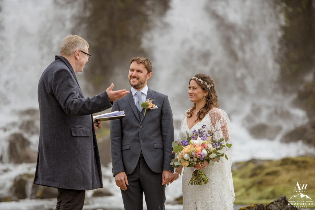 Iceland wedding couple getting married at a waterfall