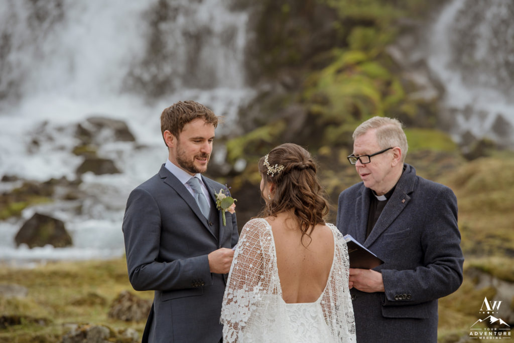 Iceland Elopement Groom saying his vows at a waterfall