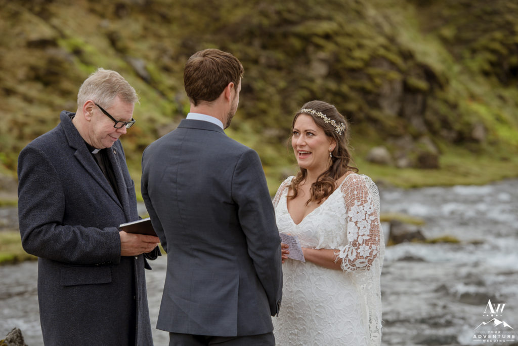 Iceland Bride saying her vows at a waterfall