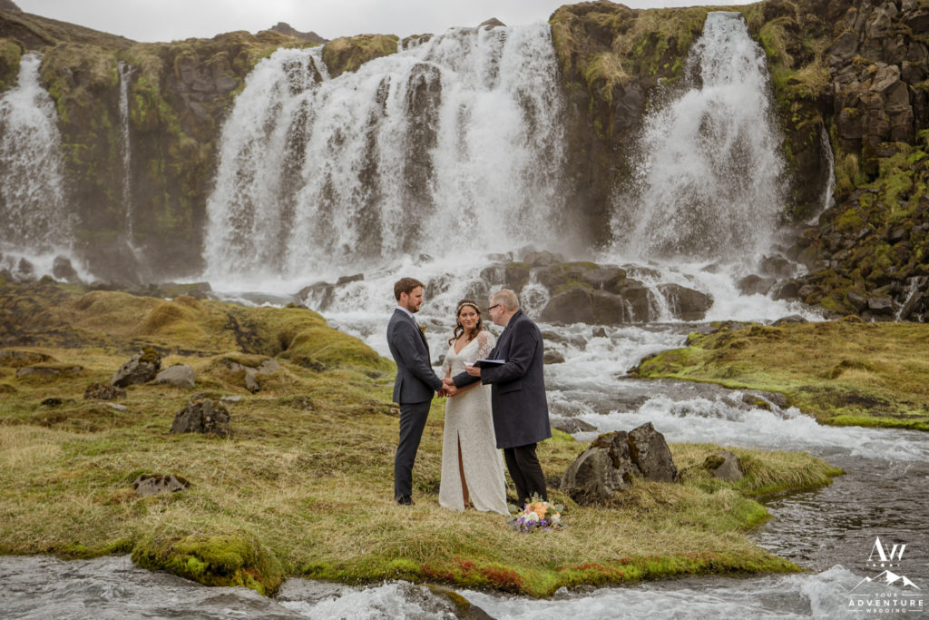 Pastor Egill marrying a couple at highland waterfall