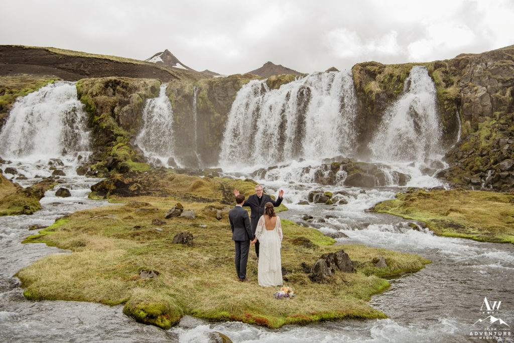 Bride and Groom getting married in Iceland at a waterfall