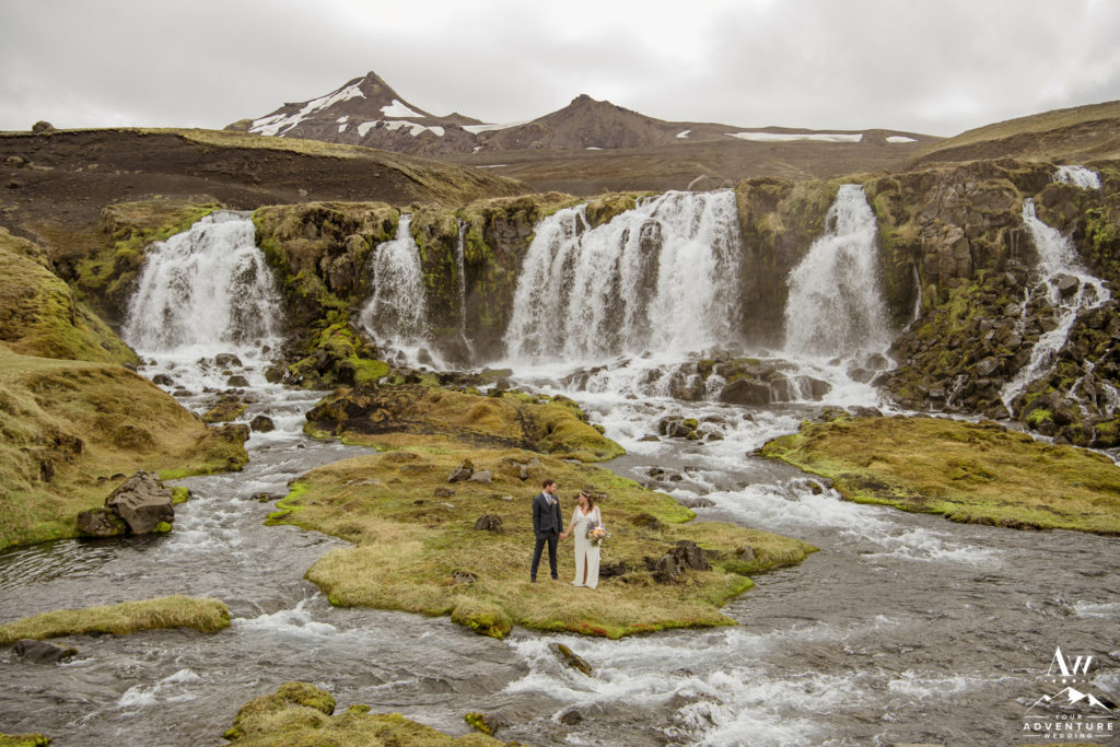 June wedding portraits at a waterfall in Iceland