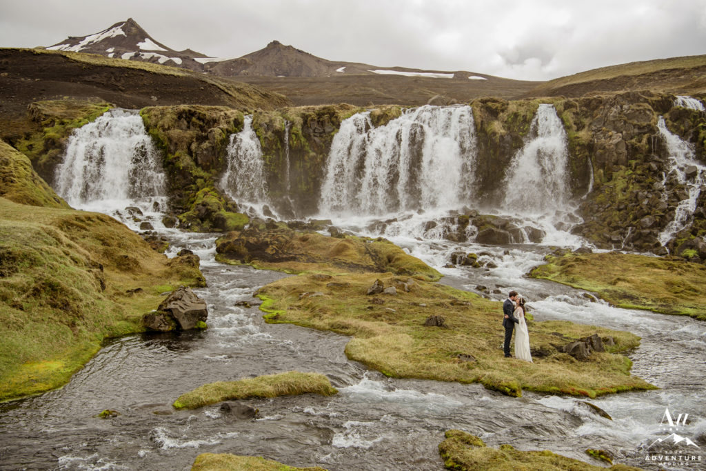 Intimate Iceland Wedding Photos in front of a waterfall