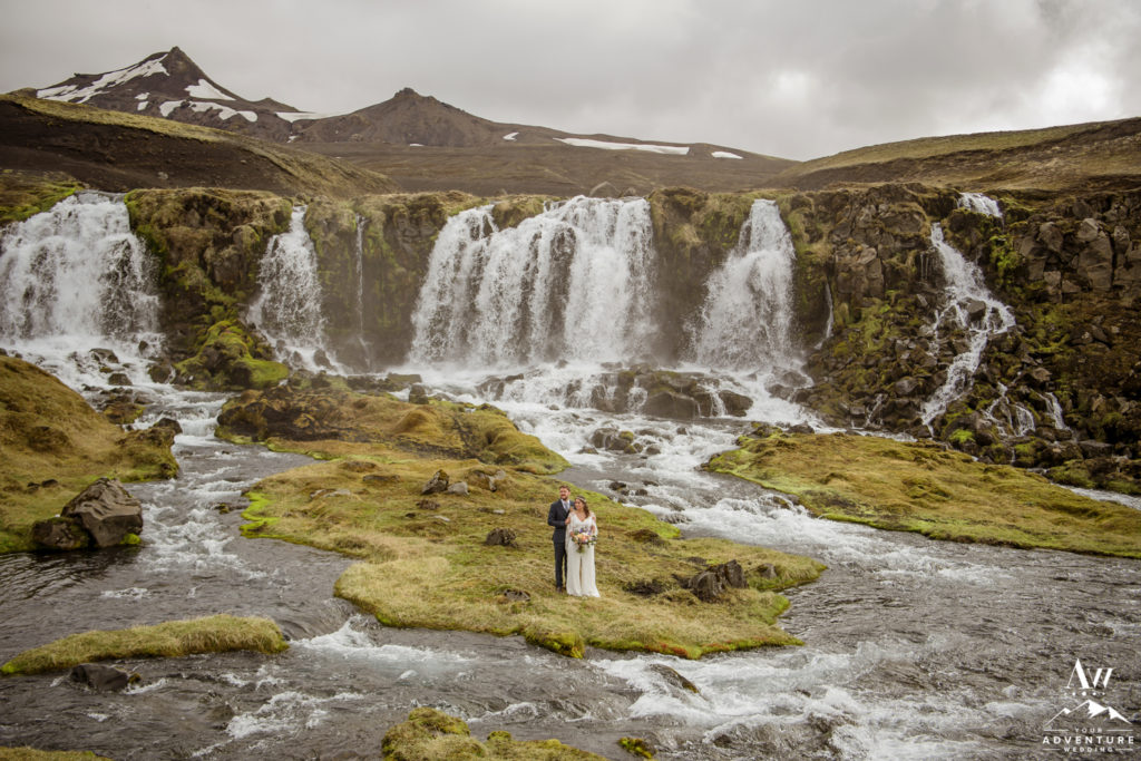 Private Waterfall Wedding Ceremony Couple standing on an island