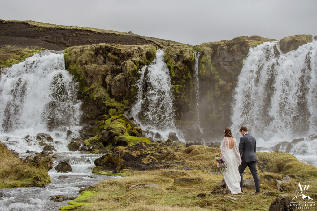 Iceland Wedding Couple Adventuring at waterfall