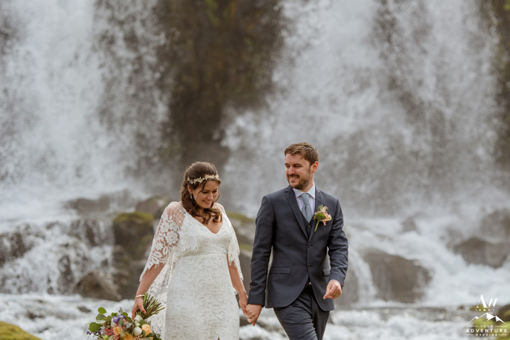 Iceland Wedding Couple adventuring at a private waterfall