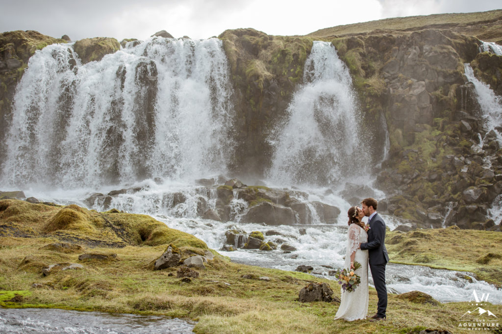 Iceland Wedding Couple kissing in front of a secret waterfall