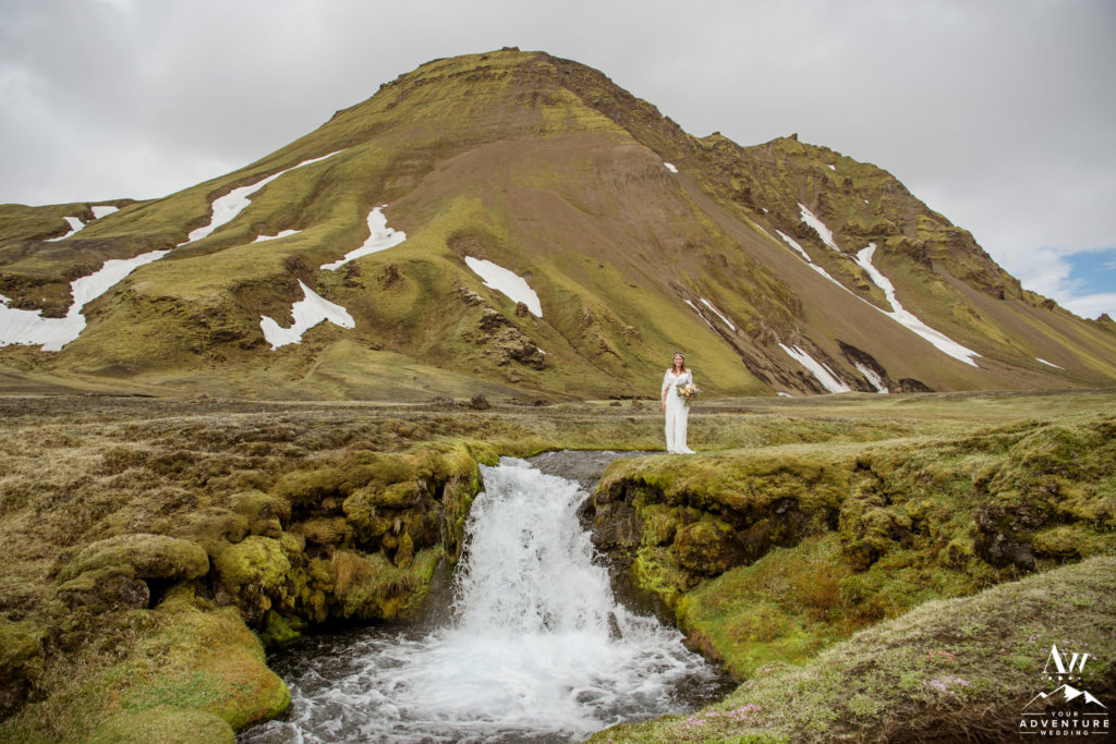 Bride standing on top of a Iceland Waterfall