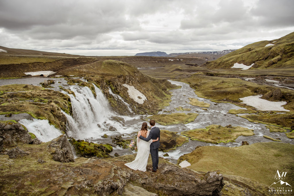 Adventurous Iceland Wedding Couple looking out to a waterfall