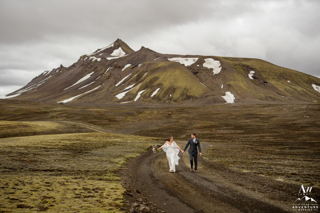 Summer wedding in Iceland couple walking on dirt road